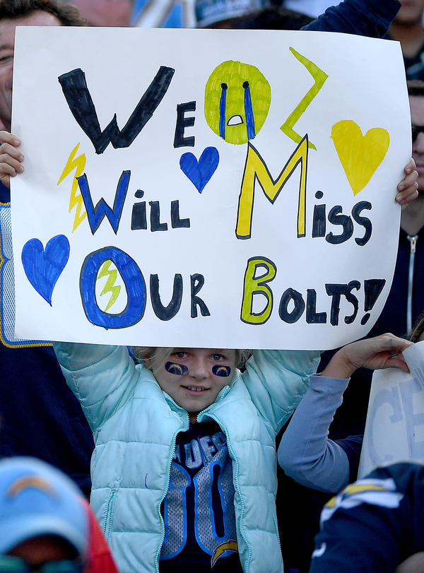 The departure was not altogether unexpected. Even the young fans saw it coming — like this girl, during the Chargers' loss to the Kansas City Chiefs on Jan. 1.