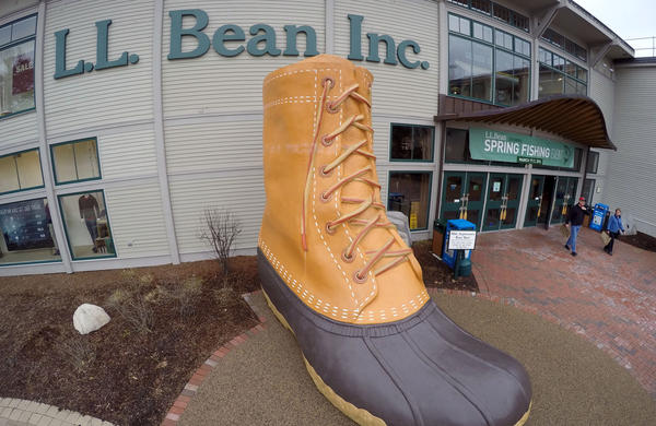 Shoppers exit the L.L. Bean retail store in Freeport, Maine.