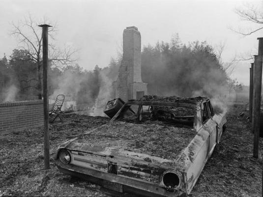 "Charred remains of Vernon Dahmer's car the morning his house and store in the Kelly Settlement of Hattiesburg, Miss., were firebombed on Jan. 10, 1966. <em>The Hattiesburg American</em> reported that ""the vehicle bore marks of a shooting."""