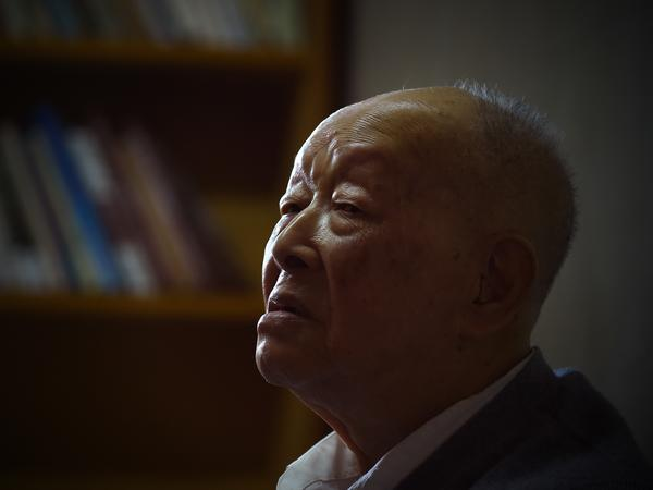 Zhou Youguang sits at home in Beijing, in 2015. Born when a Qing dynasty emperor was on the throne, he went on to help invent the Pinyin writing system used for transliterating the Chinese alphabet.