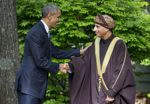 President Obama shakes hands with Oman's Deputy Prime Minister Sayyid Fahad Bin Mahmood Al Said at Camp David, Md., on May 14, 2015. Oman said Monday that it had accepted 10 prisoners being released from Guantanamo Bay in Cuba. That reduces the number of detainees remaining at Guantanamo to 45.