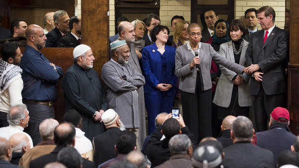 Democratic members of Congress address the worshipers at the Dar al-Hijrah Islamic Center after Friday prayers on Dec. 4 in Falls Church, Va.