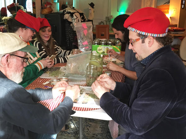 Adam Eidinger (at right, in hat), a leader of DC Cannabis Coalition, and other volunteers roll marijuana joints they plan to hand out for free on Inauguration Day.