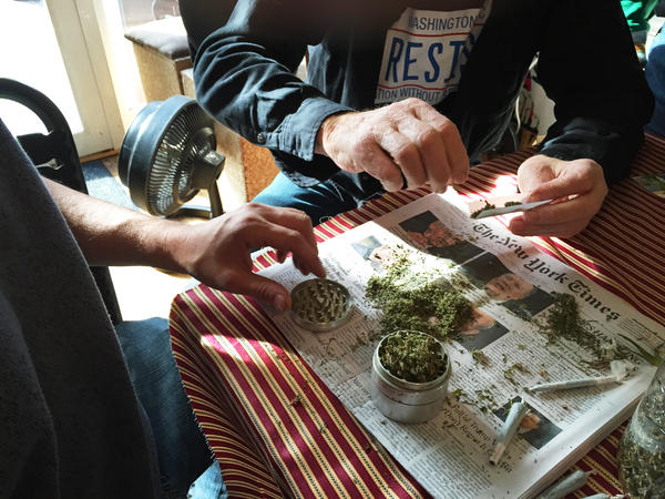 Volunteers roll marijuana in joints they plan to hand out for free on Inauguration Day. They're suggesting people light up four minutes and 20 seconds into Trump's Inaugural address to make a statement, although it's illegal to do it outside.