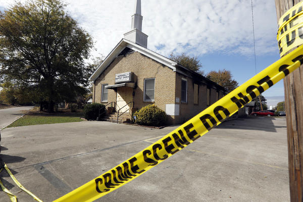 """Crime scene tape outlines the perimeter of the Hopewell Missionary Baptist Church in Greenville, Miss., on Tuesday, Nov. 22, 2016, after the church was burned and spray-painted with """"Vote Trump,"""" three weeks ago. The First Baptist Church of Greenville has offered congregants of the burned church a new place to worship.  (Rogelio V. Solis/AP)"""