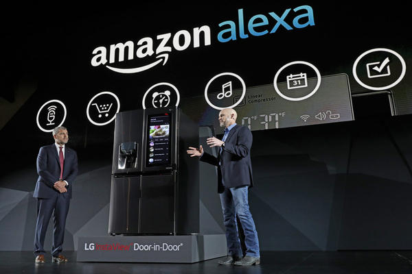 LG Electronics' vice president David VanderWaal and Amazon Echo vice president Mike George present the LG Smart InstaView Door-in-Door Refrigerator to CES 2017 attendees at the LG Electronics press conference. (Jack Dempsey/AP)