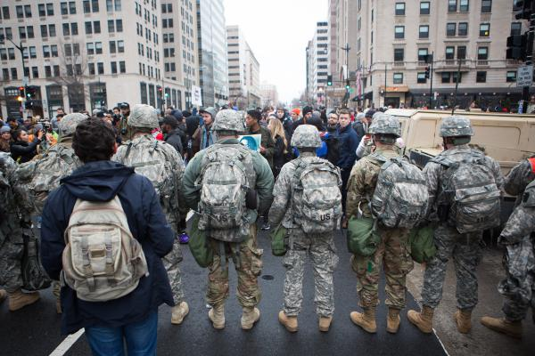 The National Guard makes a line in front of protesters at the intersection of K Street and 14th Street Northwest.