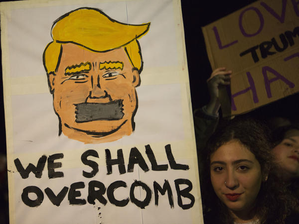 Demonstrators take part in a Women's March following the Inauguration of U.S. President Donald Trump, in front of the US embassy in Tel Aviv, Israel, Saturday.The march is being held in solidarity with the Women's March in Washington, and other cities worldwide, advocating women's rights and opposing Donald Trump's U.S. presidency.