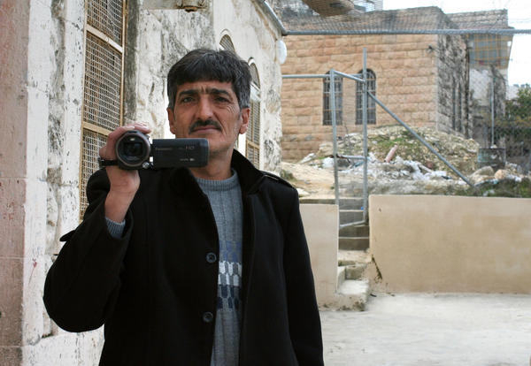 Imad Abu Shamsiyeh, a Palestinian shoemaker from Hebron, filmed an Israeli soldier shooting a badly wounded Palestinian attacker in the head last year. A military court convicted the soldier of manslaughter. Abu Shamsiyeh says he's gotten death threats for filming the attack.