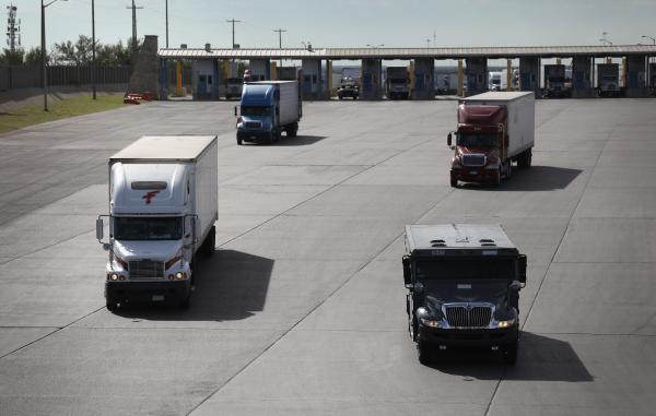 Trucks, including an armored car, pass through U.S. customs in 2016 in Laredo, Texas.