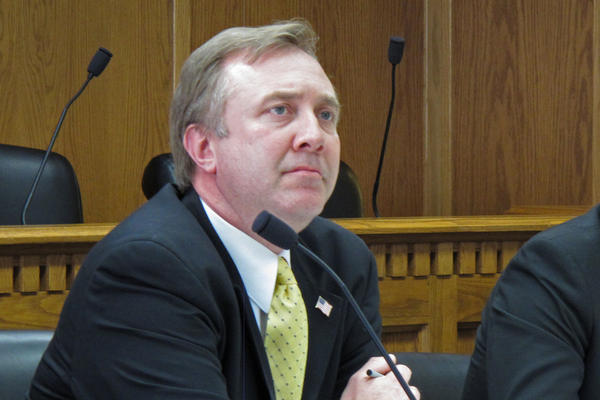 Doug Ericksen, a Washington state senator who is the head of communications for the Trump administration's EPA transition team, listens to testimony during a hearing in Olympia, Wash., in 2013.
