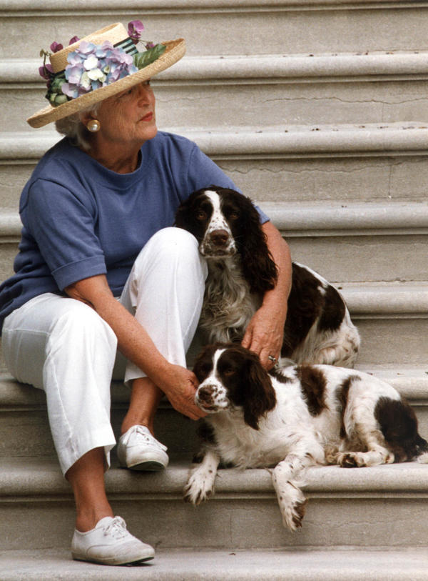 Former first lady Barbara Bush sits with Millie and Ranger on the steps of the South Portico of the White House in 1991.