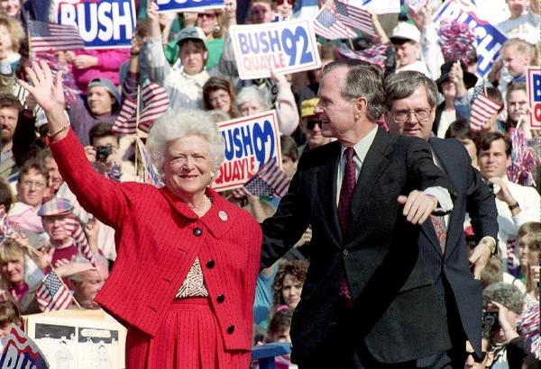 Then-President George H.W. Bush and first lady Barbara Bush wave to supporters in October 1992 at a campaign rally in Springfield, Pa.