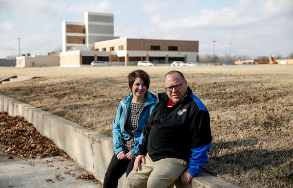 Andy Taylor and his wife, Amy, sit near the town's hospital, which was shut down in 2015.