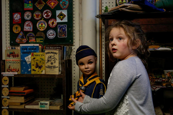 Esther, 6, explores the Scouting room at the Independence Historical Museum.