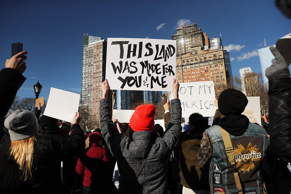 People attend an afternoon rally at Battery Park in New York City to protest President Trump's executive order.