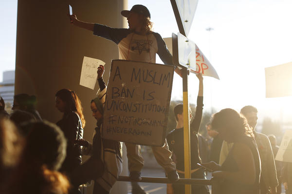 A demonstrator takes a photograph during a rally at San Francisco International Airport to protest President Trump's executive order.