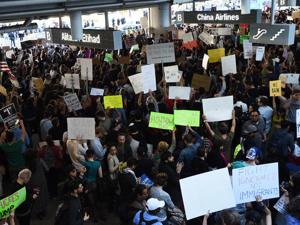 Protesters at Los Angeles International Airport rally Sunday against President Trump's executive order halting entry of refugees and others into the U.S.