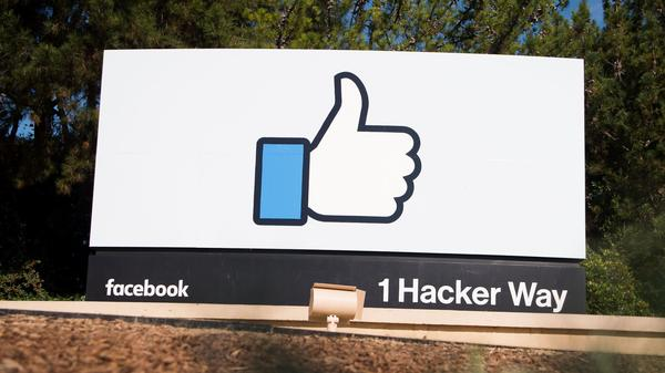 The Facebook sign and logo is seen in Menlo Park, Calif.
