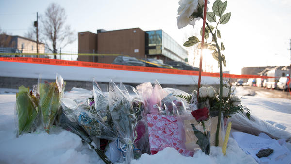 Flowers at a makeshift memorial near the Islamic Cultural Center in Quebec City Monday.