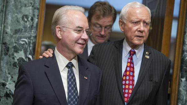 Rep. Tom Price, R-Ga., center, nominee for Health and Human Services secretary, is seen with Chairman Orrin Hatch, R-Utah, before his Senate Finance Committee confirmation hearing on Jan. 24.