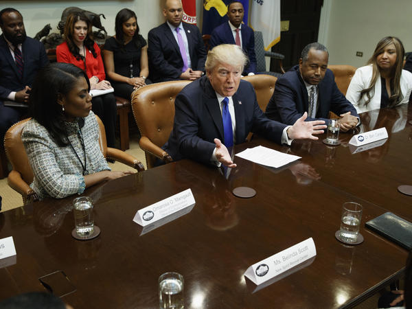 "President Trump, flanked by Omarosa Manigault and House and Urban Development Secretary nominee Ben Carson, holds an African-American History Month ""listening session"" on Wednesday."