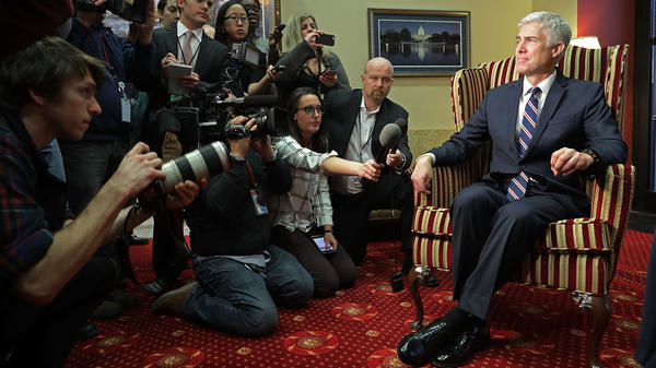 Supreme Court nominee Neil Gorsuch faces members of the media while meeting with Sen. Joe Manchin, D-W.Va., in his Senate office.