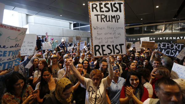 Hundreds of people protest President Trump's travel ban at LAX airport Sunday in Los Angeles.