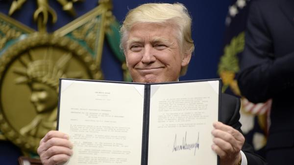 "President Trump signs two executive orders at the Department of Defenseon  Friday — calling for the ""great rebuilding"" of the military and for ""extreme vetting"" of visa seekers from seven countries."