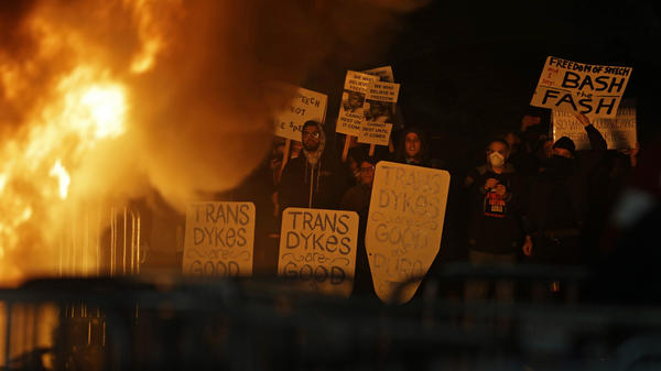 Protestors watch a bonfire on Sproul Plaza during a rally against the scheduled appearance of Milo Yiannopoulos at the University of California at Berkeley Wednesday.