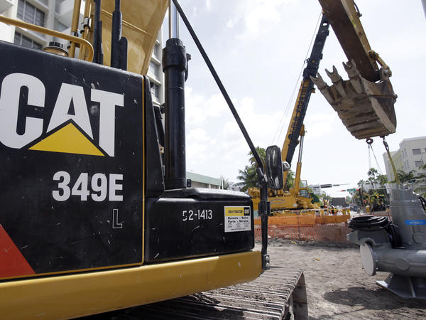 A Caterpillar excavator operates on a construction site in Miami Beach, Fla.