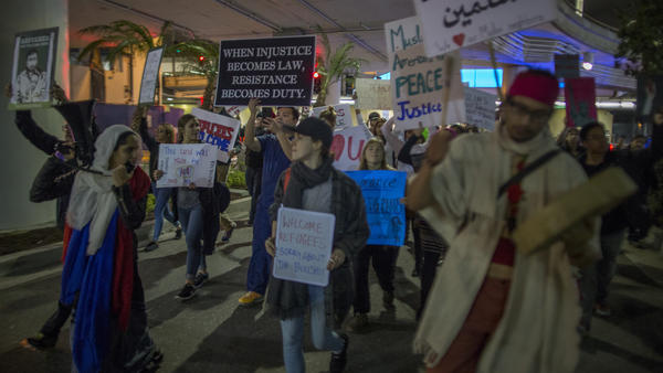 Demonstrators in Los Angeles march to support a federal judge's ruling that grants a nationwide temporary restraining order against President Trump's order to ban travel to the U.S. from seven Muslim-majority countries.