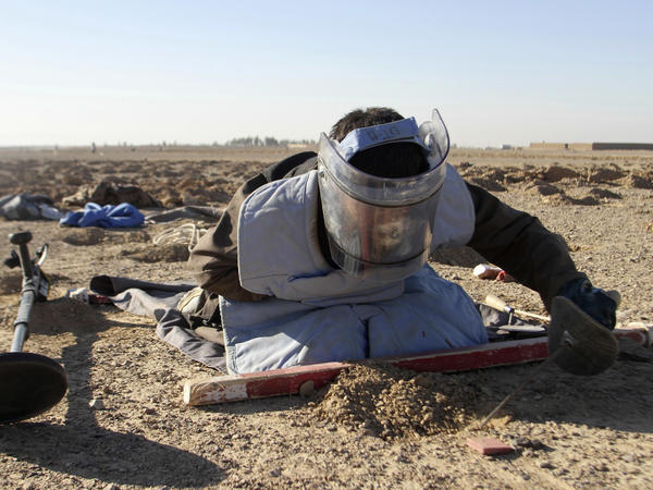 An Afghan worker searches for land mines in the Zhari district of Kandahar province in southern Afghanistan on Jan. 9.