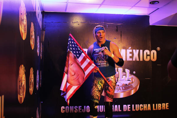 """""""Go America! Go Trump!"""" <em>lucha libre</em> wrestler Sam Adonis yells in a promotional video, beamed out to the crowd of 10,000 waiting to see him fight."""