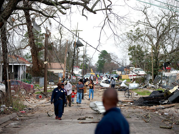 Chef Menture Avenue in New Orleans was littered with debris after severe storms on Tuesday.