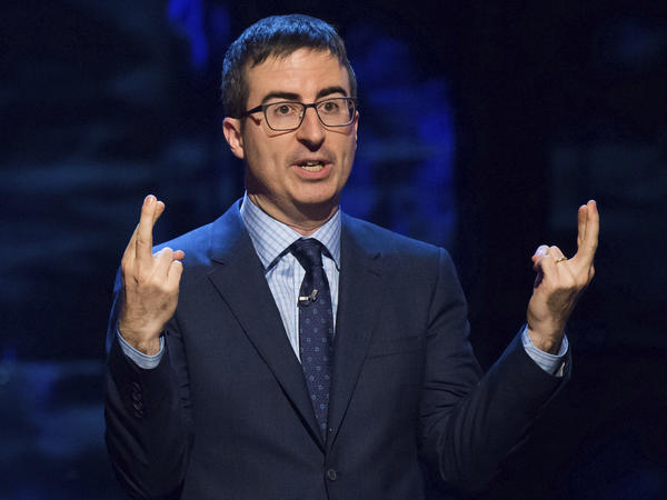 """John Oliver speaks at Comedy Central's """"Night of Too Many Stars: America Comes Together for Autism Programs"""" in New York in 2015."""