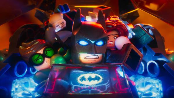 Robin (Michael Cera), Alfred Pennyworth (Ralph Fiennes), Batman (Will Arnett), Batgirl (Rosario Dawson) in <em>The LEGO Batman Movie</em>.