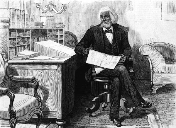 American writer, abolitionist and orator Frederick Douglass edits a journal at his desk, late 1870s. Douglass was acutely conscious of being a literary witness to the inhumane institution of slavery he had escaped as a young man. He made sure to document his life in not one but three autobiographies.