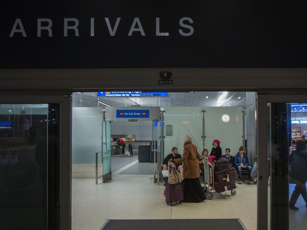 People from Yemen arrived at Los Angeles International Airport on Wednesday. On Thursday, a three-judge panel upheld a lower court's ruling that suspended President Trump's executive order banning travelers from Yemen and six other majority-Muslim countries.