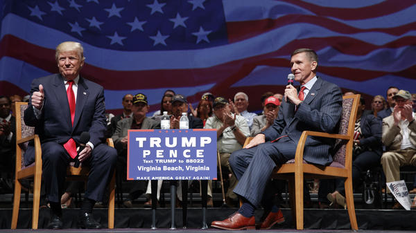 Then-presidential candidate Donald Trump gives a thumbs up as he speaks with retired Lt. Gen. Michael Flynn during a September 2016 town hall in Virginia Beach, Va.