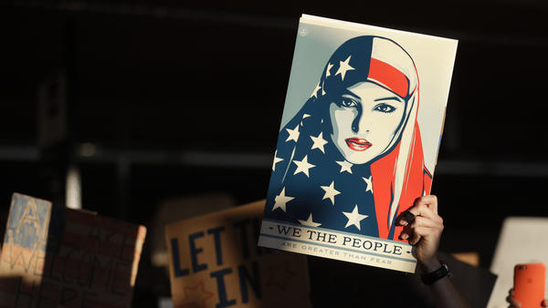 A protester holds a sign at San Francisco International Airport during a demonstration on Jan. 28 to denounce President Trump's executive order freezing immigration from seven mostly Muslim countries.