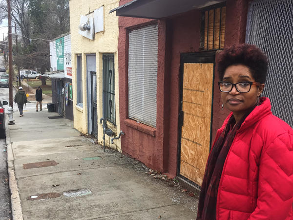 Keitra Bates stands in front of the building she plans to turn into Marddy's shared kitchen and marketplace.