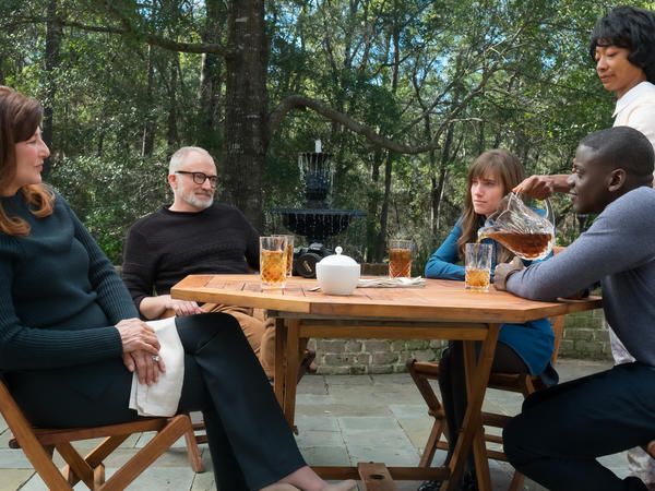 From left to right: Missy (Catherine Keener), Dean (Bradley Whitford), Rose (Allison Williams), Georgina (Betty Gabriel) and Chris (Daniel Kaluuya) in Universal Pictures' <em>Get Out</em>, a speculative thriller written, produced and directed by Jordan Peele.