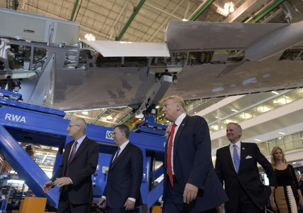 President Donald Trump tours the Boeing facility in North Charleston, S.C., with CEO Dennis Muilenburg (left) on Friday to see the 787 Dreamliner.