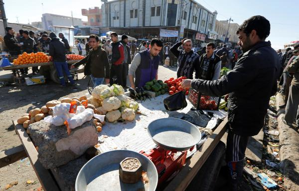 People shop after returning to their homes in east Mosul in January.