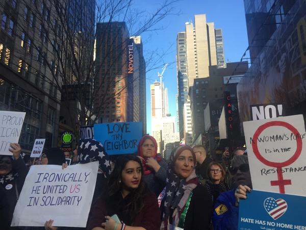"""Amal Bajes, sporting a printed American flag hijab, was at the """"I Am Muslim Too"""" rally in New York City's Times Square with her daughter on Sunday."""