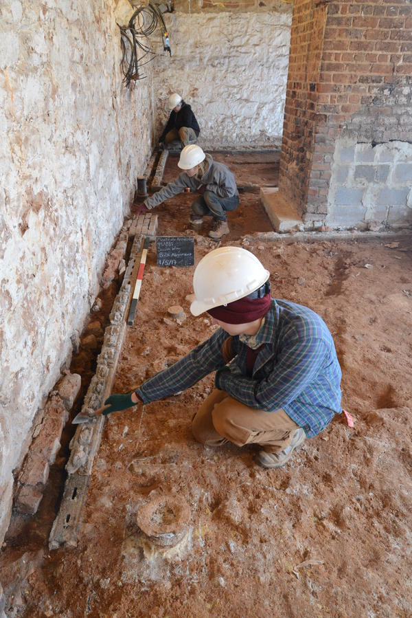 Archaeologists uncover the original brick floor of what is believed to be Sally Hemings' living quarters at Monticello.