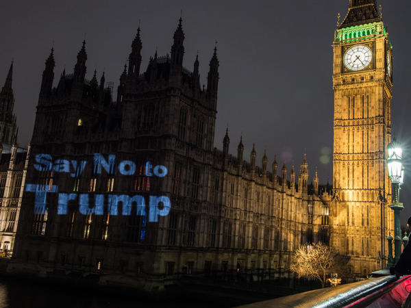 "A message of ""Say no to Trump"" is projected on Britain's Houses of Parliament the evening before a Monday parliamentary debate took place on Donald Trump's state visit. Nearly 2 million people signed a petition in support of scrapping or downgrading the invitation."
