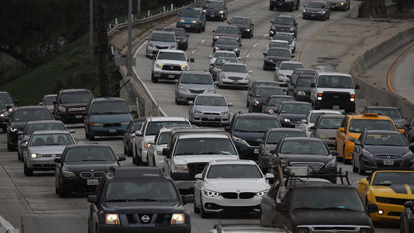 Cars on Highway 101 in Los Angeles on Tuesday. Around the nation, Americans drove a record number of miles last year.