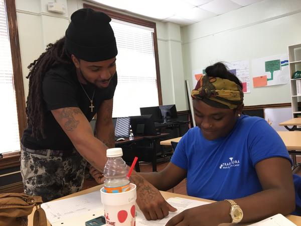 """Darren Alridge works as a """"para-instructor"""" at the Youth Empowerment Project. He says police have yet to convince him that they're serious about bringing killers to justice in his community."""